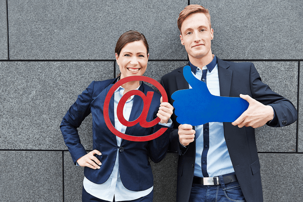 Email hosting - 2 persons holding @ sign and like icon